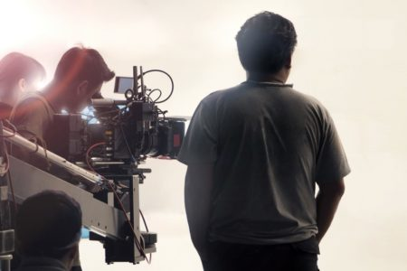 Film crew in studio with cameras and equipment